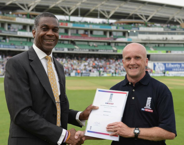 Steve Taylor cricket coach, Holding a coaching award. </br>He's the chap on the right hand side, alas.